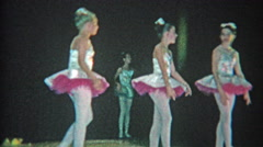 1963: Ballet troupe young girls dancing on black background grade school stage. Stock Footage