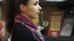 Woman inside a deli waiting at counter - stock footage