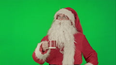 Santa drinks from a red cup on a Green Screen Chrome Key Stock Footage
