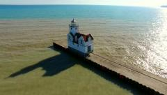 Scenic Flyover of Lighthouse on Lake Michigan Stock Footage