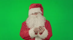 Santa claus reads and sends text messages from his cell phone  on a Green Screen Stock Footage