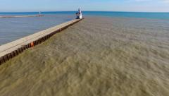 Scenic Flyover of Lighthouse on Lake Michigan, Kewaunee, Wisconsin Stock Footage