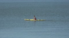 A man kayaking in Seurasaari Bay close to Seurasaari Island, Helsinki, Finland. Stock Footage