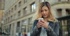 Young Asian woman texting cell phone in city Stock Footage
