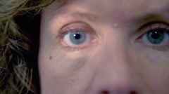 Close up of blue eyes caucasian woman doing eyes examination Stock Footage