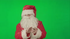 Santa talking on his cellphone with a surprised look on his face. on a Green Stock Footage
