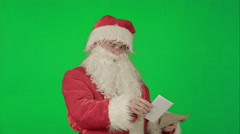 Santa Claus reading letters from children on a Green Screen Chrome Key - stock footage