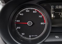 Car tachometer with pointer showing middle power - stock photo