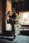 Warrior with gun targeting at dangerous point Stock Photos