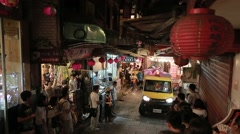 Trash truck in nigth market of Jiufen Old Street near Keelung, Taiwan-Dan Stock Footage