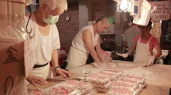 Street vendors preparing yam balls chinese, night market Jiufen Old Street-Dan Stock Footage