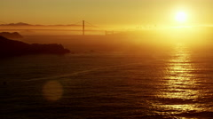 Stock Video Footage of Aerial sunrise view San Francisco California Point Bonita Lighthouse