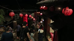 People walking and shopping in Night market of Jiufen Old Street, Taiwan.-Dan Stock Footage
