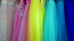 Various wedding dresses of different colors at shop Stock Footage