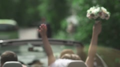 the bride and groom in a convertible - stock footage