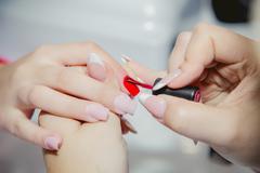 Manicure in a beauty salon, master class - stock photo