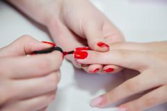 Manicure in a beauty salon, master class Stock Photos