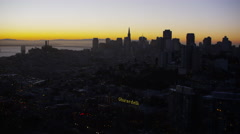 Aerial sunrise San Francisco illuminated city Downtown Skyscrapers Stock Footage