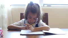 Stock Video Footage of little girl doing homework math counting uniform clever concentrated future 4k
