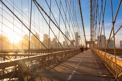 Brooklyn bridge at sunset, New York City. - stock photo