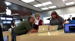 People buying new Macbook inside Apple store - stock footage