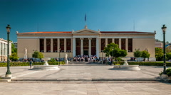 Students wait for Graduation ceremony in front of University of Athens building Stock Footage