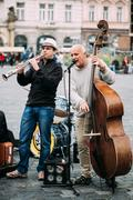 Street Busker performing jazz songs at the Old Town Square in Pr Kuvituskuvat
