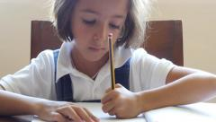 Stock Video Footage of little girl doing homework after school in uniform clever concentrated future 4k