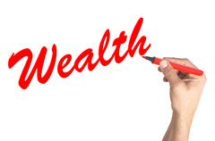 Stock Photo of Hand writing word Wealth on white board