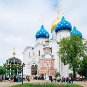 People walking near Dormition - Assumption Cathedral. Built in 1559 - 1585 in Stock Photos
