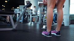 Dumbbell squat woman workout exercise at gym - stock footage