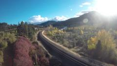 Aerial View: Country Valley With Train Tracks and River Stock Footage
