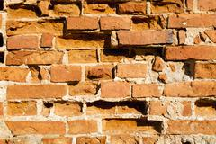 destroyed brick wall - stock photo