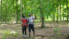 4K Attractive African American couple hiking in the woods.  Stock Footage