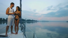 Couple in love relaxing on a yacht. - stock footage