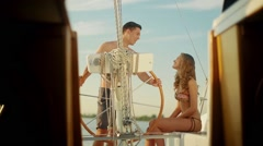 Guy and a girl relaxing on a yacht. Love story. - stock footage