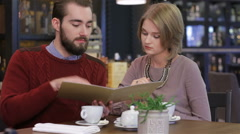 Stock Video Footage of Couple chooses the menu