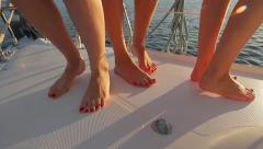 Girls dancing on board. Legs of girls close-up. Arkistovideo