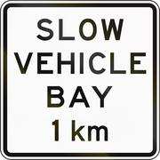 New Zealand road sign - Slow vehicle bay ahead in 1 kilometre - stock illustration