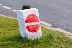 No entry road sign painted onto rock Stock Photos
