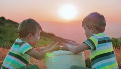 Beautiful countryside scenery on sunset two kids play with wheat grains - stock footage