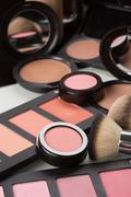 make-up cosmetics. compact powder, mineral foundation and makeup brushes - stock photo