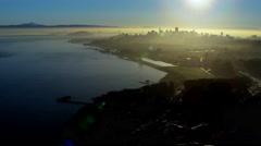 Aerial sunrise San Francisco USA city Bay Bridge coastline Stock Footage