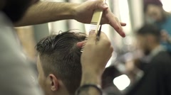 Close-up barber drying hair of a young bearded man Stock Footage