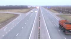 Movement of cars on the road out of focus Stock Footage
