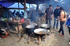 Meat boiling in a caldron in Bac Ha market, Vietnam Stock Photos