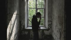 Young man in an abandoned house is upset , nervous. Stock Footage