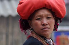 Stock Photo of SAPA, VIETNAM - FEBRUARY 24, 2013: Unidentified Red Dao (Red Yao, Dzao) woman