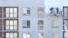 Workers men paint newly build modern house walls in white. 4K Stock Footage