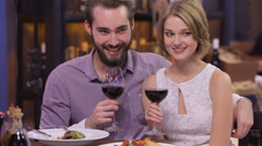 Picture of engaged couple with wine glasses - stock footage